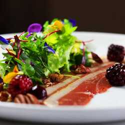 Duck breast salad with blackberry and pecan